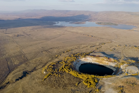 Ore production in the earths crust. Filled with water mine workings 写真素材