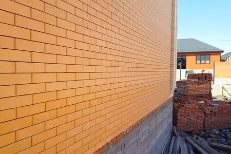 The house is made of yellow silicate brick. The walls and facade of the house are made of brick.
