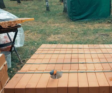 a Construction of red brick, brick masonry.