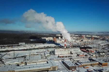 Industrial landscape, view of the factory and boiler room. Smoke from the chimney.