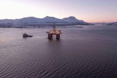Drilling platform in the port. Towing of the oil platform.