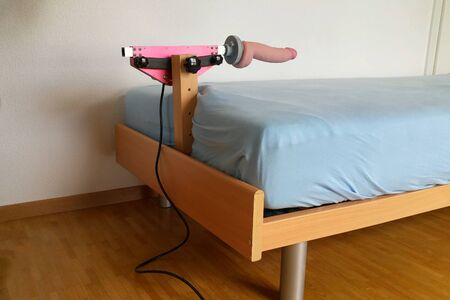 Mechanism for games attached to the bed Фото со стока