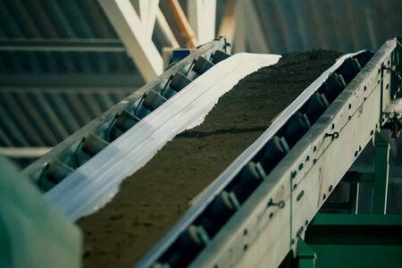 Clay conveyor line for brick production. Brickworks. Stock fotó