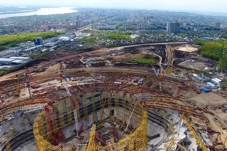 Moscow, Russia - May 12, 2018: Equipment for the construction of the stadium. Tower cranes and construction machinery. Construction of the stadium.