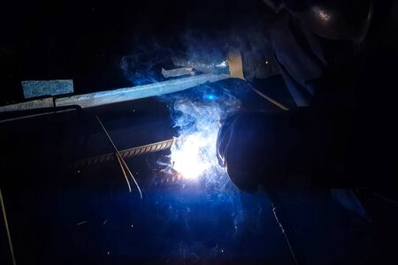 Welding of steel reinforcement. Sparks and light from welding. Electric welding.
