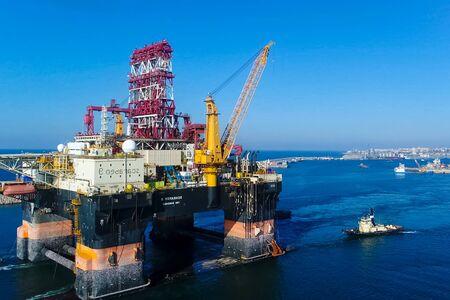 Bergen, Norway - June 27, 2014: Drilling platform in the port. Towing of the oil platform.