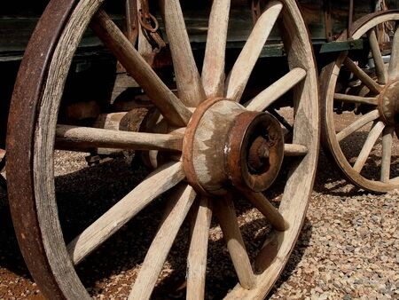 pioneering: Antique wooden stagecoach wheel Stock Photo
