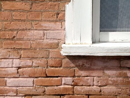 Country red brick wall & white window frame