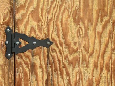 Raw wood with black rustic hinge photo