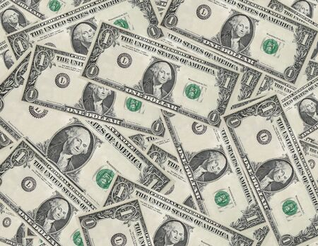 removed: Dollar bills with serial numbers removed scattered background Stock Photo