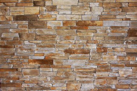 red brick repetition: Rich brown stone wall background landscape