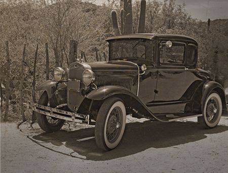 antique: Antique automobile in grunge distressed image Stock Photo