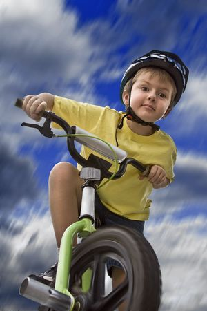 Young boy riding his bicycle, low angle shot Stock Photo