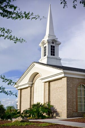 Rural church  with large steeple photo