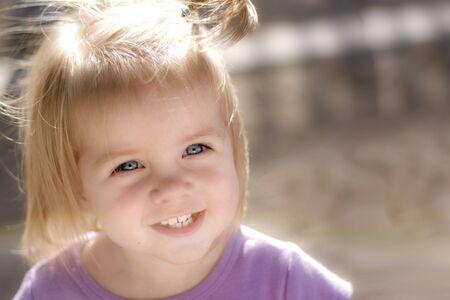brown hair blue eyes: Blue eyed  girl happy at play