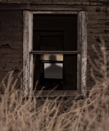 ghostly: Spooky Silhouette in Old Farm House