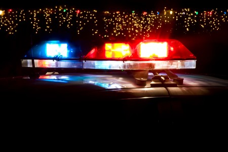 Police Car Lightbar in Front of Christmas Decorations