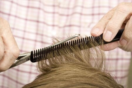 Black comb guiding the scissors to make a perfect haircut Stock Photo - 4102789