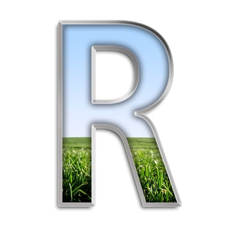 grass field: Capital letter R made of grass & blue sky Stock Photo