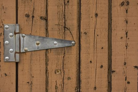 Steel hinge on rustic wood photo