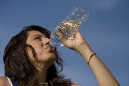 Happy healthy teenager with water bottle Stock Photo - 5136581