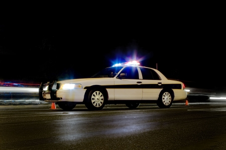 light duty: Police car at traffic scene at night Stock Photo