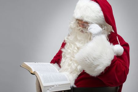 Santa Claus reading from the bible photo