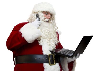 Santa Claus with modern technology Фото со стока
