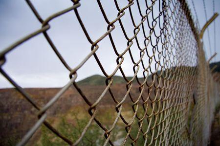 rusty chain: Desert border fence