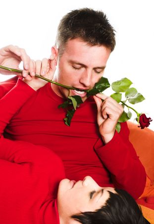 Young couple is having a date. The man tries to be very romantic and keeps the rose between his teeth. Stock Photo - 428199