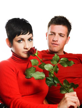 Young couple is having a date. The woman got a red rose. Stock Photo - 428198