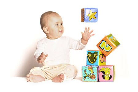 11 moths old baby plays with toy cubes. One of the cubes is levitating... at least it looks like. Stock Photo - 436447
