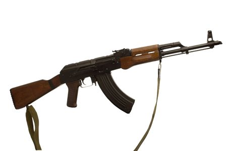 fugitive: The famous AK-47 kalashnikov assault rifle. Well know all alround the world and in all conflict zones. Stock Photo