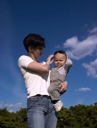 The one year old baby just 'stole' his mother's sunglasses and now he is pridefully wearing it. Stock Photo - 474918