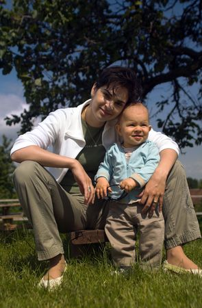 Baby and his mother are togather in the garden. Stock Photo - 474899