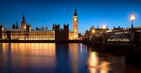 The famous landmarks of London: The Parliament, the Big Ben and the Themes by night.