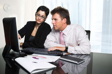 successfull: Young businesspeople are working in team. Stock Photo