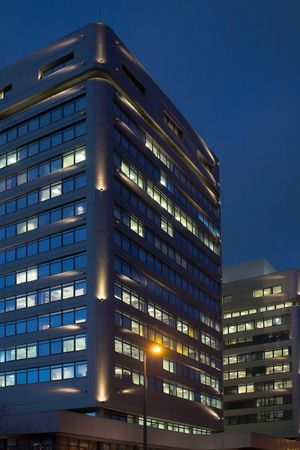 A night-time officebuilding with lights in the windows. photo