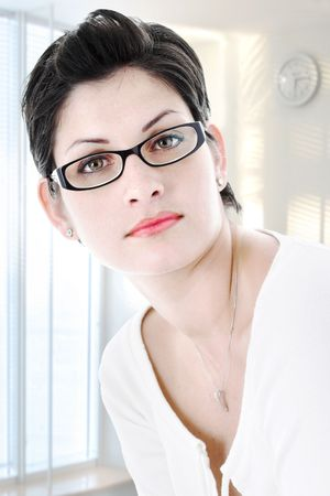A very determined and beautiful young businesswoman in trendy glasses. Stock Photo