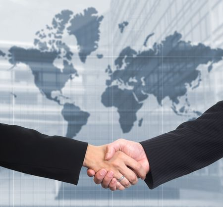successfull: Conceptual image: Man and woman are shaking hands after a business deal. Stock Photo