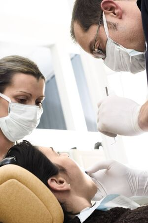 medical attendance: Young female patient takes a dental attendance in the dentists office.