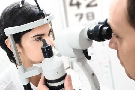 diopter: Beautiful young female patient is having a medical attendance at the optometrist.