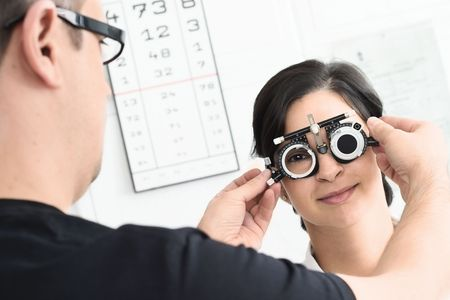 medical attendance: Beautiful young female patient is having a medical attendance at the optometrist.