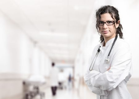 Young female doctor on the corridor of the hospital.