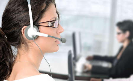Pretty young woman works as an IT helpdesk operator. Stock Photo - 841449