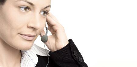 eye service: Young female operator wears a headset.