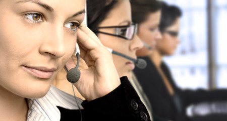 Young female operators in headset.  Stock Photo - 1414053