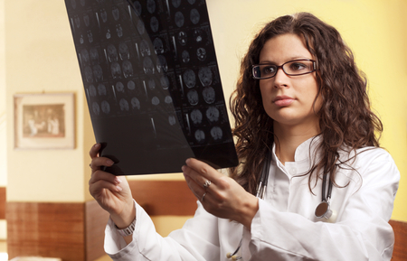 radiogram: Young female doctor examines a radiogram. Stock Photo
