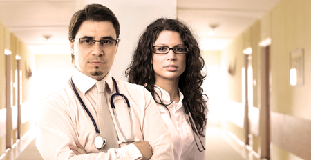 inoculation: Portrait of two determined young doctors, taken on the hospital corridor.