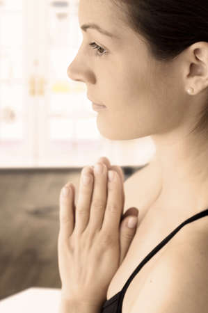 Young woman is doing a traditional yoga exercise. Stock Photo - 1414262